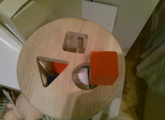 Child game square peg with different shape holes